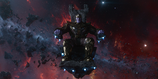 Thanos is sitting on his chair.