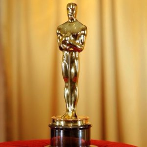 It looks like an Oscar, except the little golden dude is holding a gun to the head of an actor's child.